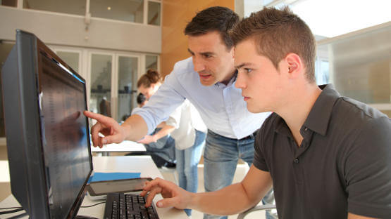 Young boy learning to use online accounting software